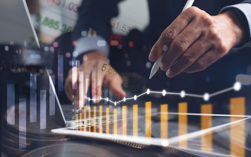 Business analysis, financial investment concept. Businessman, analyzing stock market report on digital tablet and laptop computer with market summary and financial graph